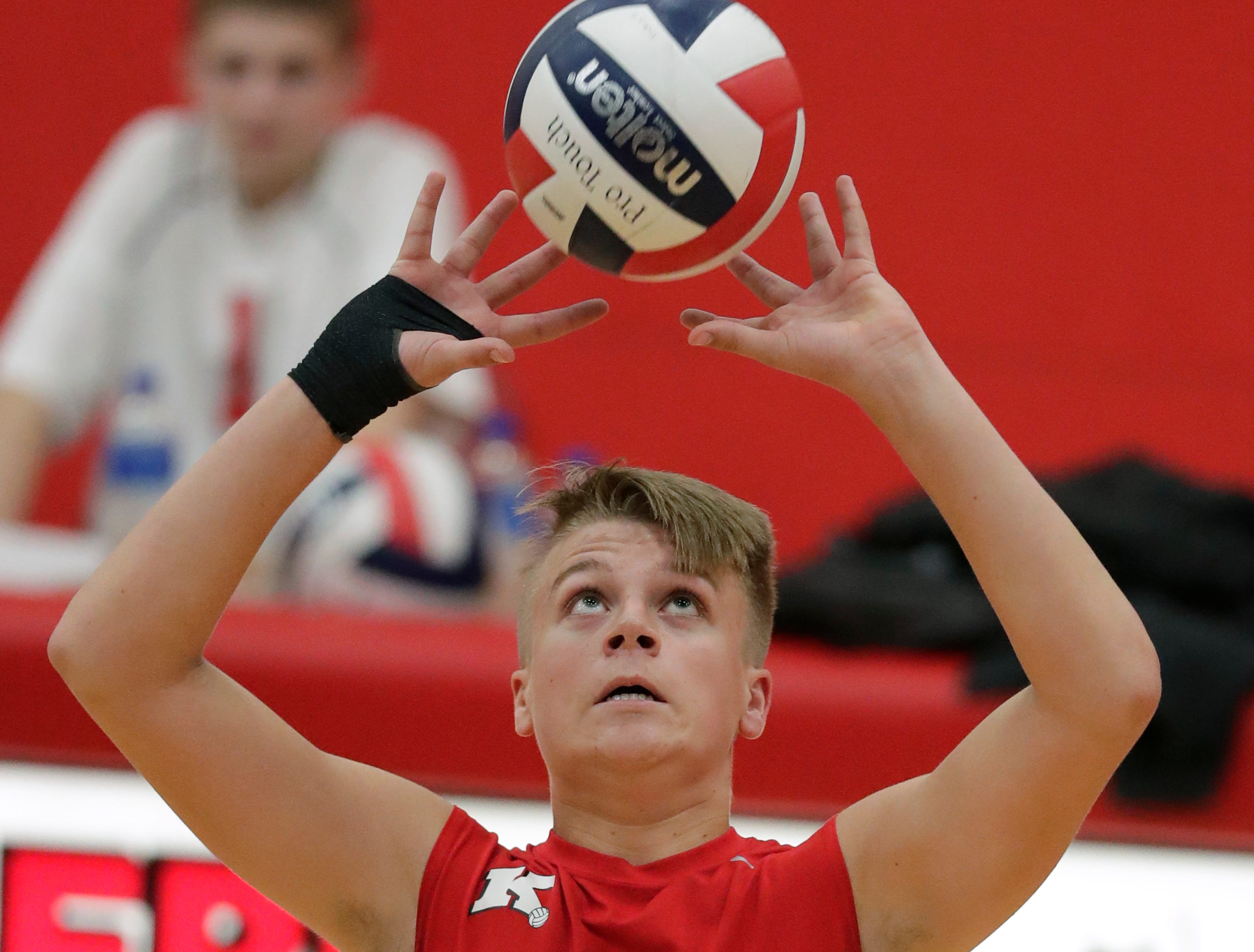 Kimberly High School's Chase Robinson (5) sets the ball against Appleton North High School during their boys volleyball match Tuesday, Oct. 9, 2018, in Kimberly, Wis. 