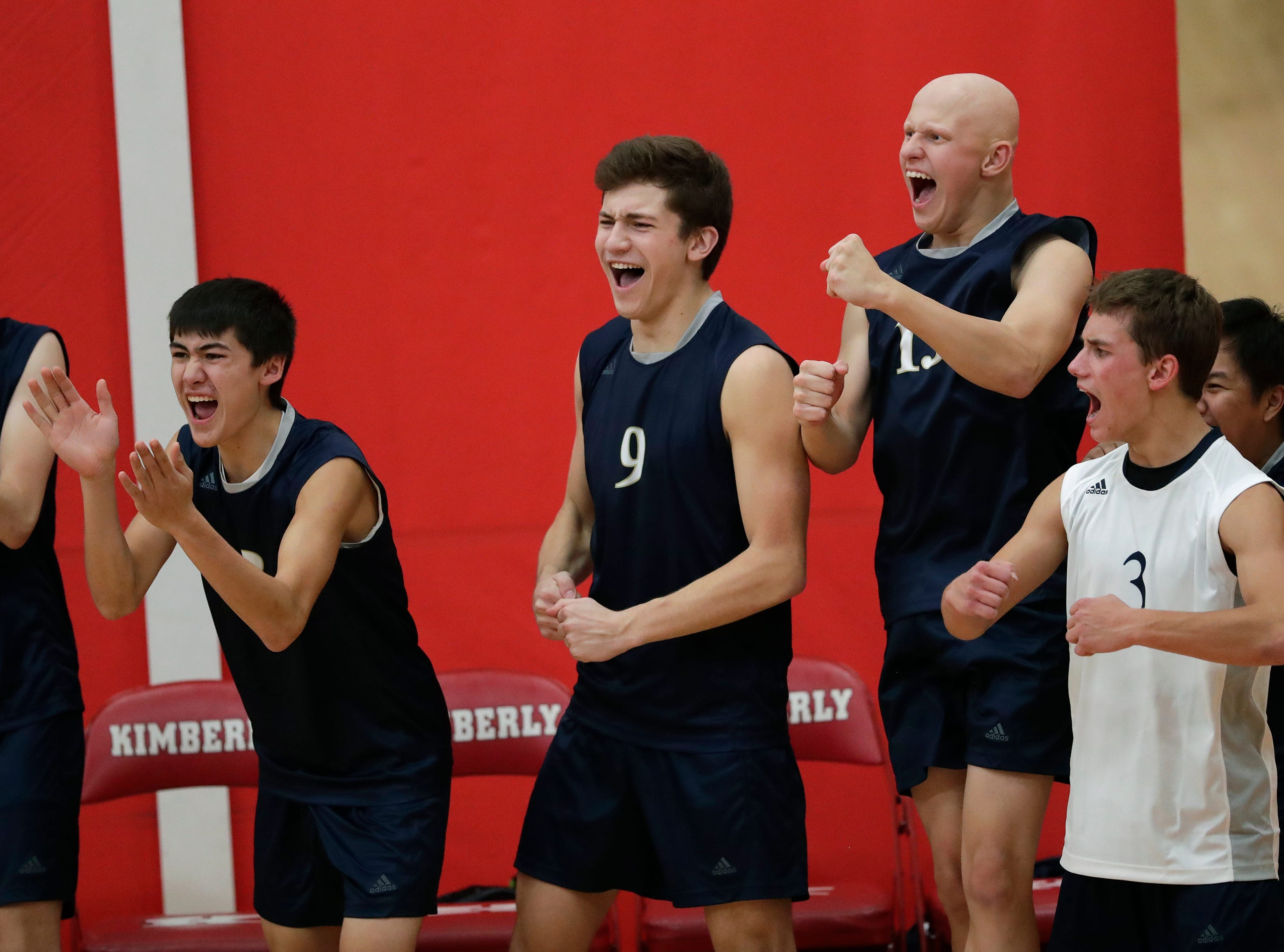 Appleton North High School's players celebrate winning a point against Kimberly High School during their boys volleyball match Tuesday, Oct. 9, 2018, in Kimberly, Wis. 