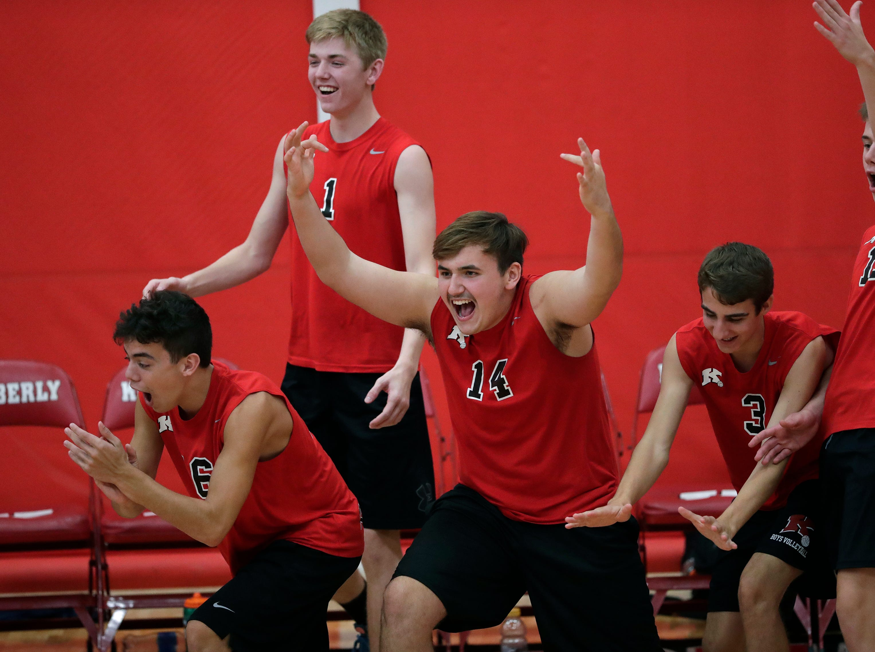 Kimberly High School's players celebrate winning a point against Appleton North High School during their boys volleyball match Tuesday, Oct. 9, 2018, in Kimberly, Wis. 