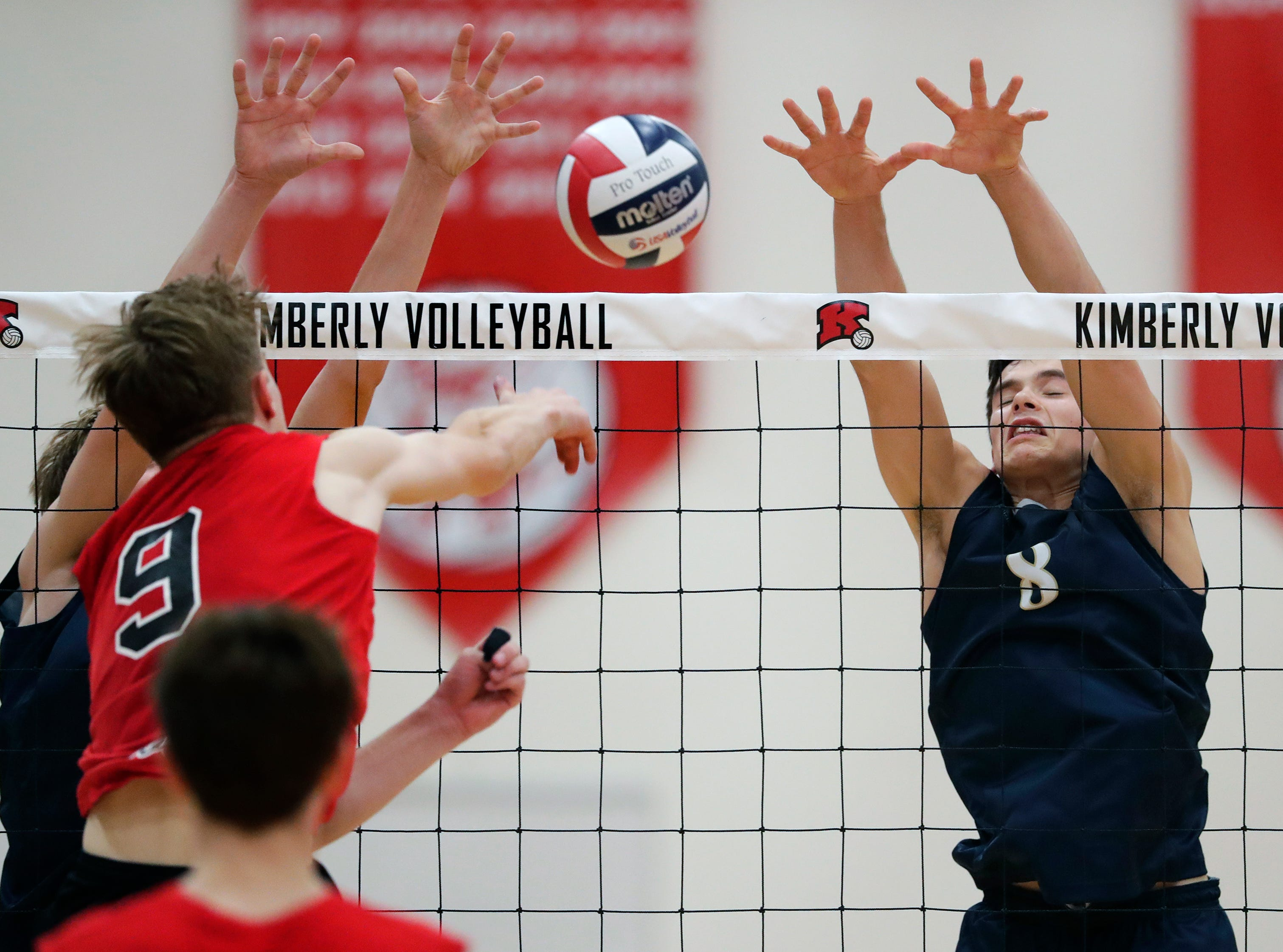 Appleton North High School's Andrew Woodbury (8) defends against Kimberly High School's Tommy Clausz (9) during their boys volleyball match Tuesday, Oct. 9, 2018, in Kimberly, Wis. 