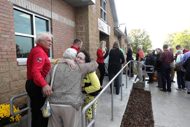 Attendees line up for a tour during the grand opening of the new LEAVEN Community Resource Center on Wednesday in Menasha.