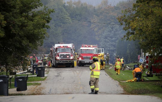 Firefighters and first responders work at the scene of a home explosion Wednesday at W5639 Firelane 12 in Harrison.