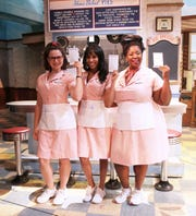 """Waitress"" cast members Katie Lowes, Nicolette Robinson and NaTasha Yvette Williams will wear pink waitress uniforms to support Susan G. Komen Greater NYC for Breast Cancer Awareness Month this October at The Brooks Atkinson Theatre in New York City."