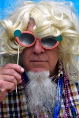Reporter-News editor Greg Jaklewicz tries on long hair for the first time in the 21st Century Tuesday Oct. 9, 2018 at Bunco for Breast Cancer, held in the Taylor County Coliseum.