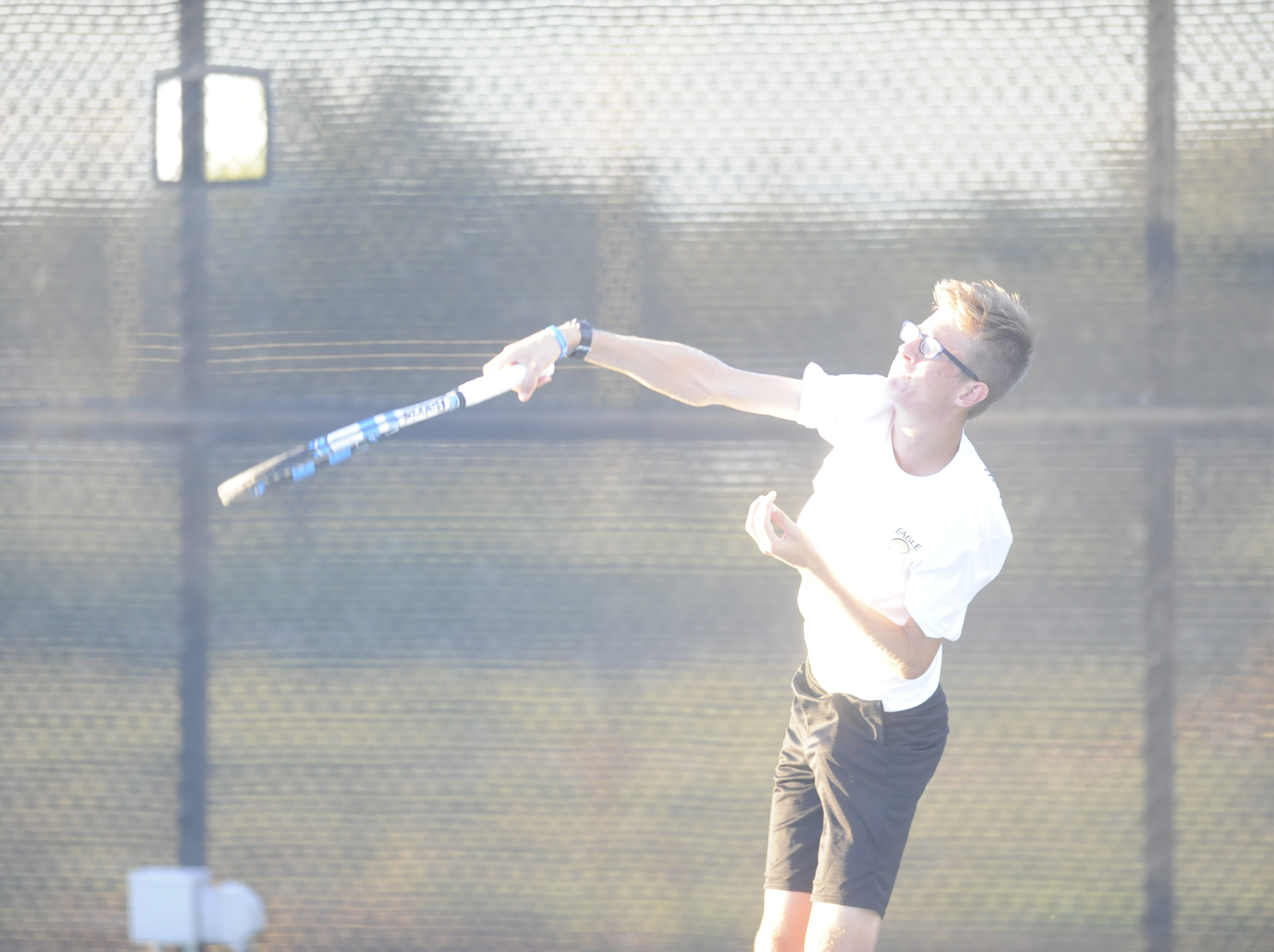 Abilene High's Brady Moore hits a serve during a match against San Angelo Central Oct. 9th, 2018.