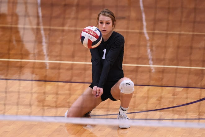 Wylie libero Pierson Sanders (1) goes to one knee to return a serve during the Lady Bulldogs' 3-0 loss to Aledo at Bulldog Gym on Tuesday, Oct. 9, 2018.