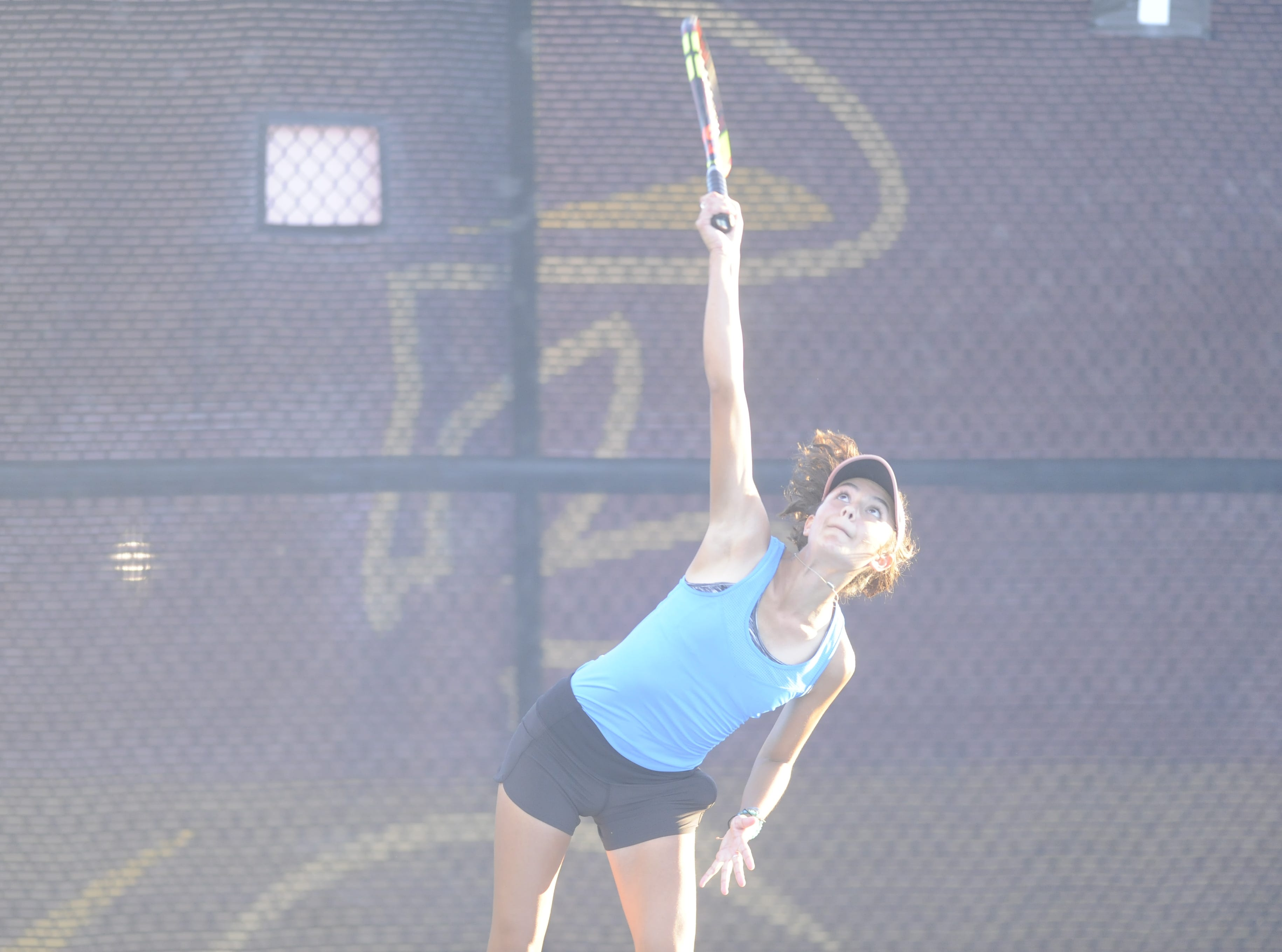 San Angelo Central's Olivia Henderson serves during a match against Abilene High Oct. 9th, 2018.