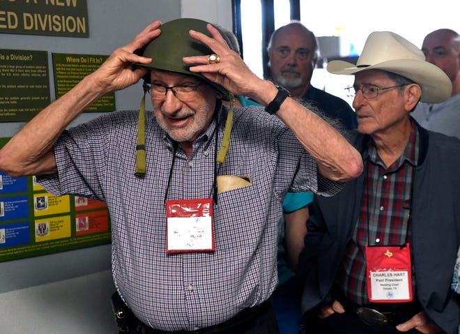Marty Berman of Houston tries on a World War II U.S. Army helmet Oct. 6 at the 12th Armored Division Museum. Members of the Texas Jewish Historical Society toured the museum as part of their quarterly meeting in Abilene.
