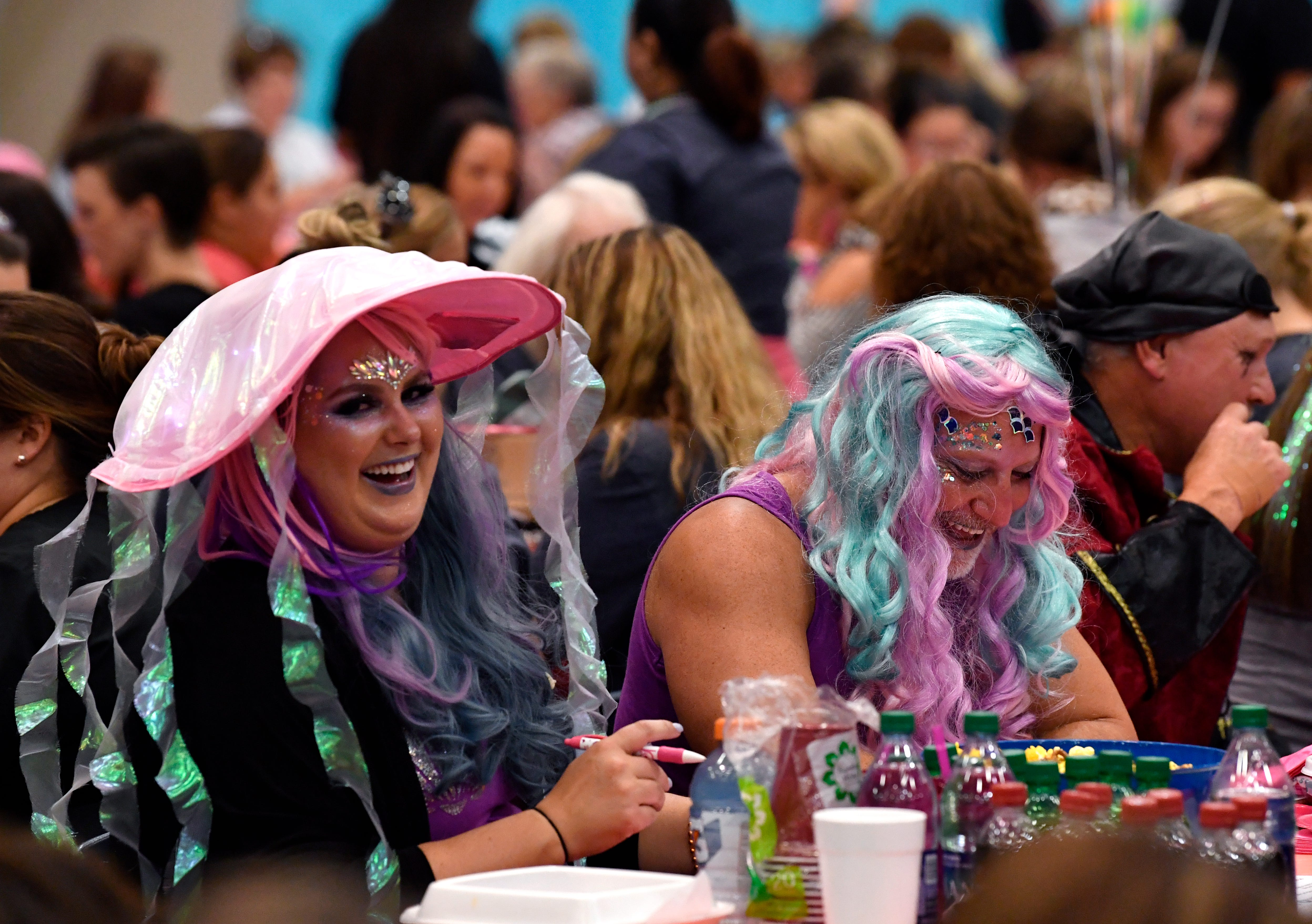 Jenna Dozier (left) and Todd Sinclair laugh while playing during Bunco for Breast Cancer Tuesday .