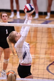 Wylie setter Lexie Miller (11) passes the ball during the Lady Bulldogs 3-0 loss to Aledo at Bulldog Gym on Tuesday, Oct. 9, 2018.