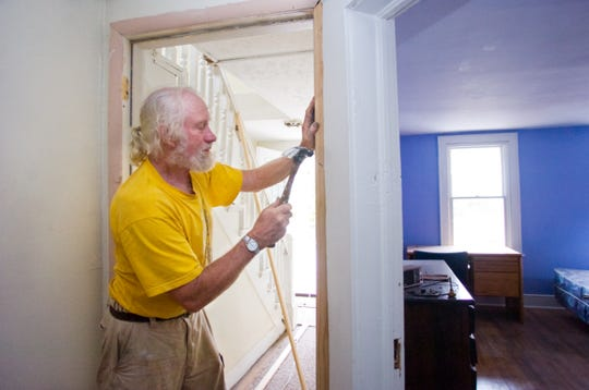 Dick Andrus renovates a house located 68 Pine Street in Binghamton in 2010.