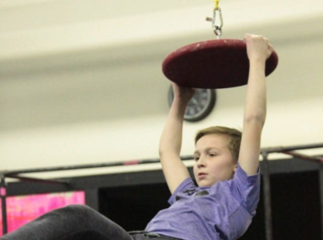 Evan on a UFO during a National Ninja League competition at Hybrid Fitness in Buffalo.