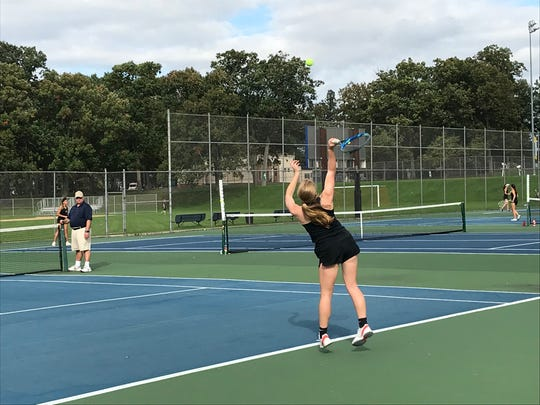 Union-Endicott's Alexis Harris serves to Seton CC's Amanda Bucko in the second singles match of Tuesday's STAC final at Rec Park. Bucko won, 6-0, 7-5.