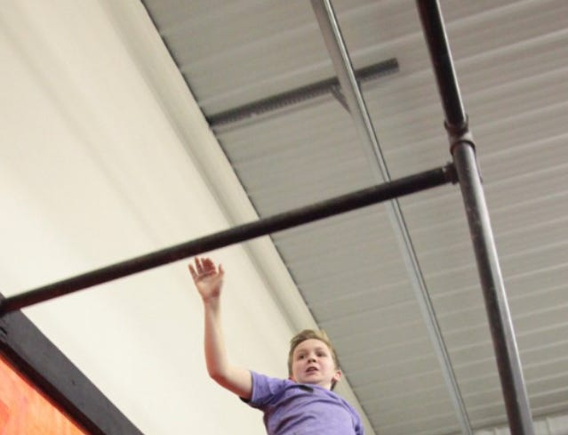 Evan completing a lache at a competition at Hybrid Fitness in Buffalo.