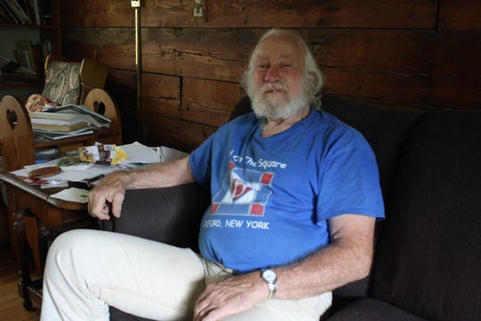 Dick Andrus sits in the living room of his Binghamton home.