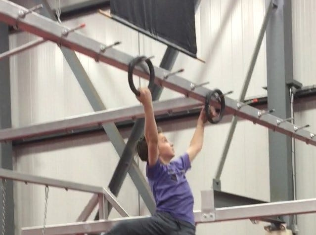 Evan on the rings during a National Ninja League competition at Double Dragon in Kitchener, Ontario.