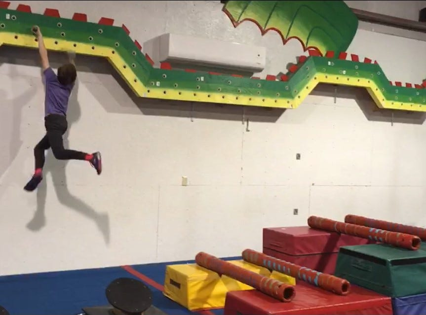 Evan was the youngest to traverse end-to-end on this Peg Monster of over 120 holes at Freedom Gymnastics in Brodheadsville, Pennsylvania.