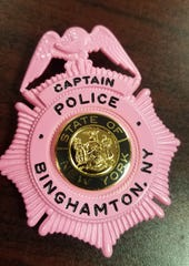 """Binghamton Police Department members will be wearing pink badges throughout the month of October as part of the American Cancer Society's """"Real Men Wear Pink"""" campaign."""