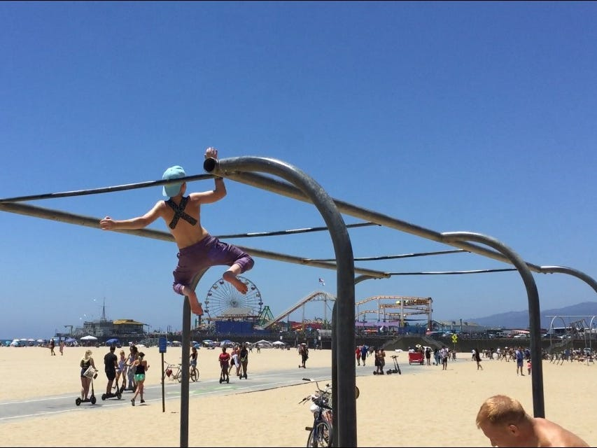 On a day off from production for American Ninja Warrior Junior, Evan Wenzinger practices at Santa Monica beach.