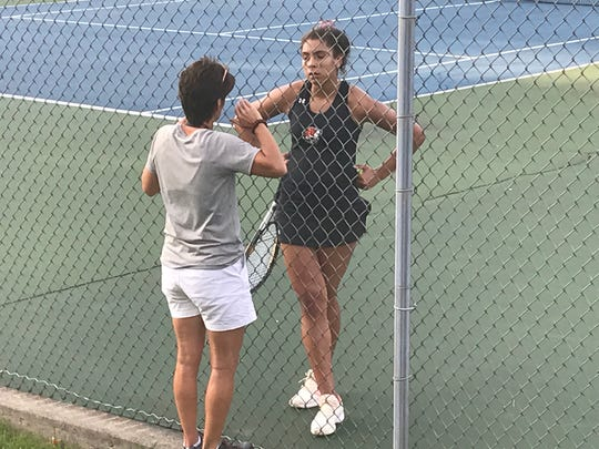 Union-Endicott third singles player Lexi Brooks talks with coach Teresa McKinney during her match against Seton CC's Bridget Martin in Tuesday's STAC final at Recreation Park. Martin pulled out a 3-6, 6-3, 7-5 victory that lifted the Saints to a 4-3 win.