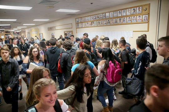 South Kitsap High School students jam a hallway as they to class.