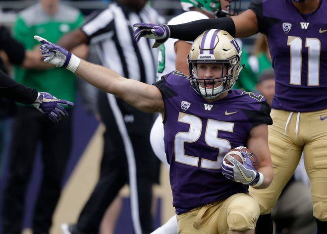 Washington's Ben Burr-Kirven has been one of the best defensive players in college football this year. He and the other Husky defenders will need to apply more pressure on Oregon's Justin Herbert than they did last week on UCLA's Dorian Thompson-Robinson.