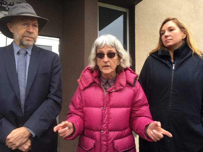 Defendant Annette Klapstein, center, speaks outside Clearwater County courthouse in Bagley, Minn., after she was acquitted along with two other defendants on Tuesday.