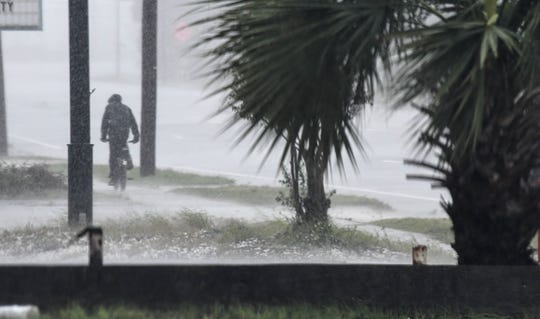 A bicyclist braves the rain as Hurricane Michael approaches Panama City, FL Mandatory Credit: Craig Bailey/FLORIDA TODAY via USA TODAY NETWORK