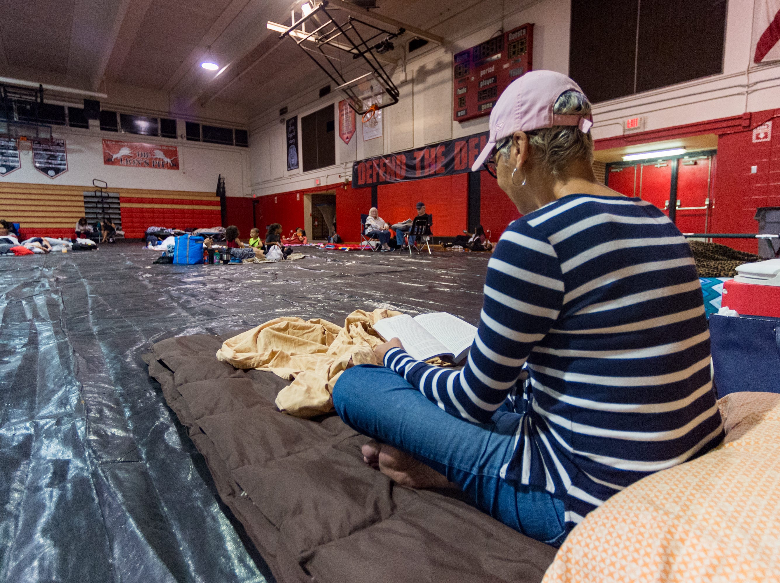 Tallahassee  residents take shelter at the Leon High School Gym as Hurricane Michael approaches the Florida Coast. Wednesday, Oct. 10, 2018.