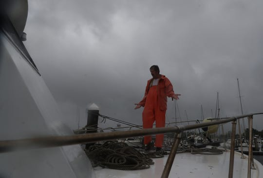 Mike Paprocki finishes up tying his fishing boat at a marina in Panama City, Fl on Wednesday 10/9/2018. He was preparing for the onslaught of Hurricane Michael.