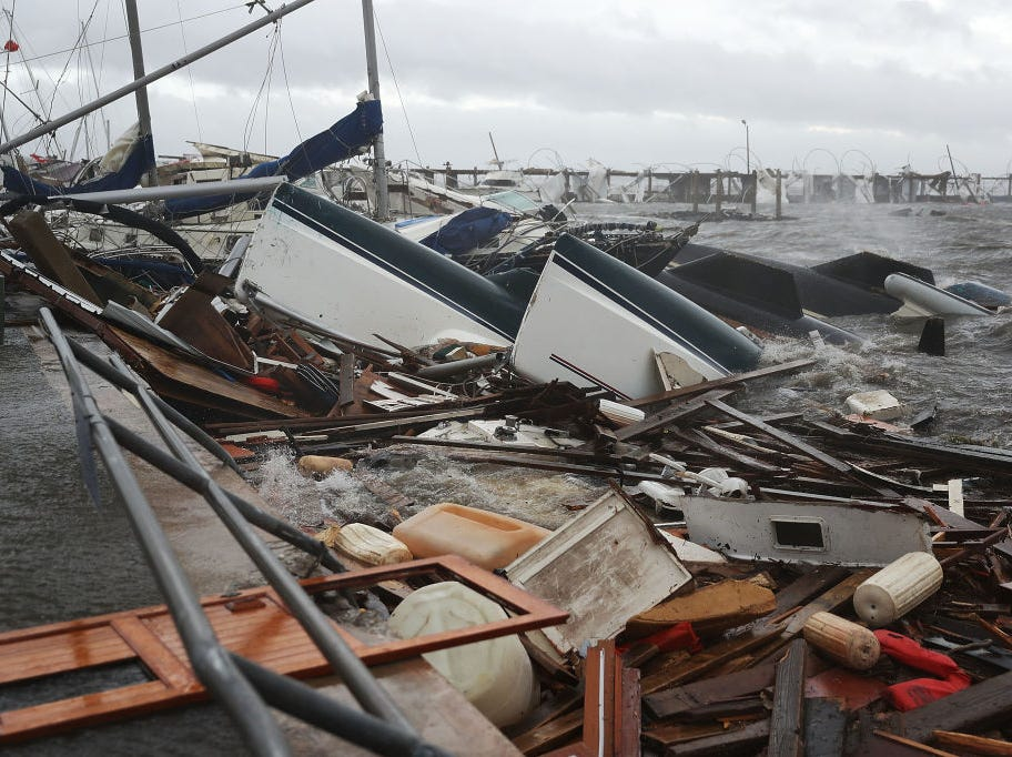 PANAMA CITY, FL - OCTOBER 10:  Boats that were docked are seen in a pile of rubble after hurricane Michael passed through the downtown area on October 10, 2018 in Panama City, Florida. The hurricane hit the Florida Panhandle as a category 4 storm.  (Photo by Joe Raedle/Getty Images)