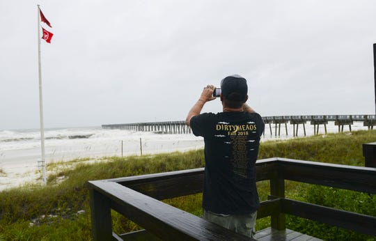 Bob Harper of Panama City Beach takes pictures of the surf at the Panama City Beach Pier as Hurricane Michael approaches. Mandatory Credit: Craig Bailey/FLORIDA TODAY via USA TODAY NETWORK