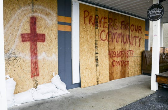 Sandbags, boards and a prayer request guard the front of South Iron Customs motorcycle shop on Panama City Beach. Mandatory Credit: Craig Bailey/FLORIDA TODAY via USA TODAY NETWORK