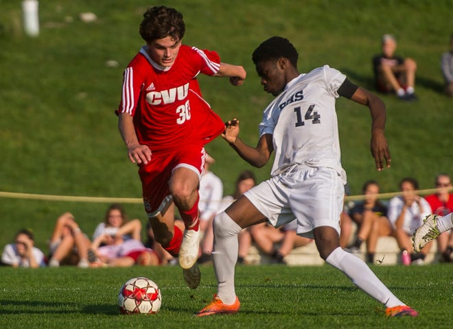 CVU #30 Jack Sinopoli fights for the ball against Burlington's #14 Hussein Murbarak during their boy's high school soccer game in Hinesburg on Tuesday, Oct. 9, 2018. CVU won, 2-0.