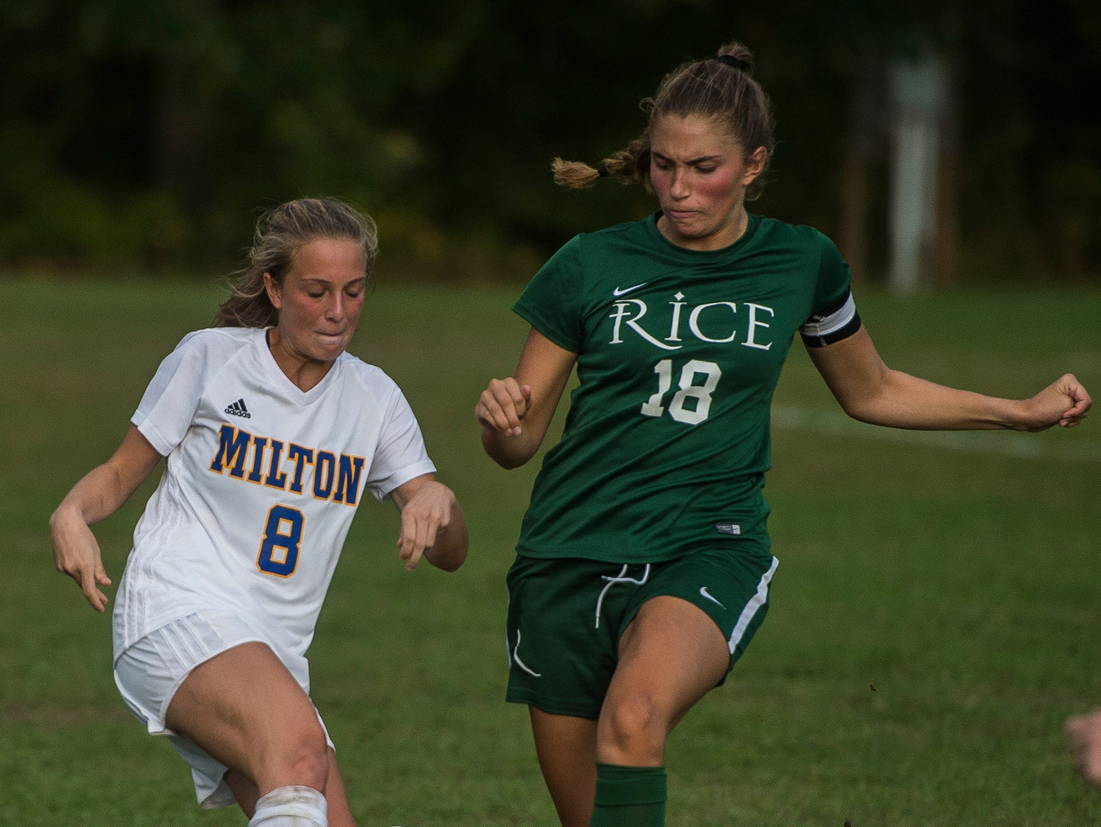 Milton #8 Molly Loucy forward the ball just ahead of Rice #18 Abby McKeown during their girl's high school soccer game in South Burlington on Wednesday, Oct. 10, 2018. Milton won, 2-1.