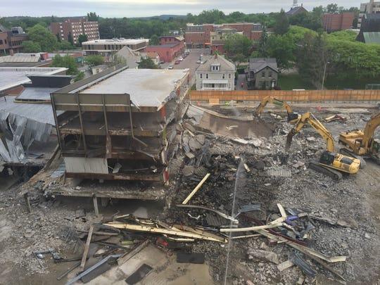 The final section of the Burlington Town Center garage in Burlington, Vermont, comes under assault by heavy equipment on June 1, 2018. The demolition of Burlington Town Center began in December 2017 to make way for CityPlace Burlington.