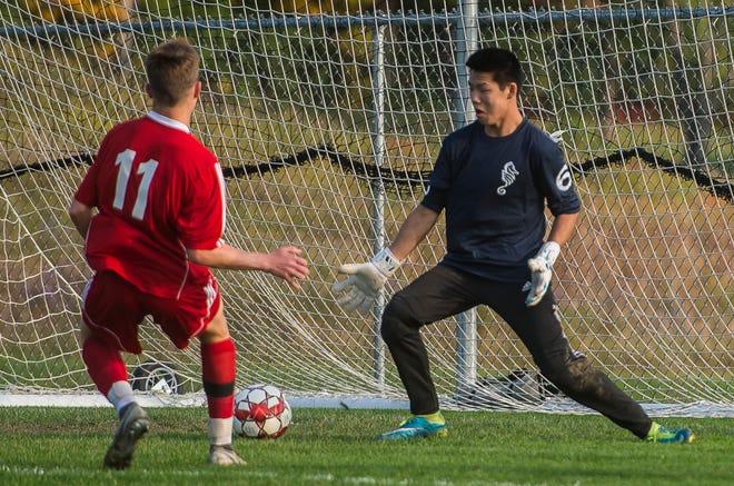 CVU #11 Caleb Martin fires a shot past Burlington goalie Elliot Maher during their boy's high school soccer game in Hinesburg on Tuesday, Oct. 9, 2018. CVU won, 2-0.