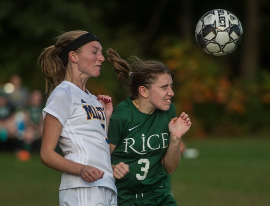 Milton #3 Morgan Bushey heads to ball over Rice #3 Sadie Vincent during their girl's high school soccer game in South Burlington on Wednesday, Oct. 10, 2018. Milton won, 2-1.