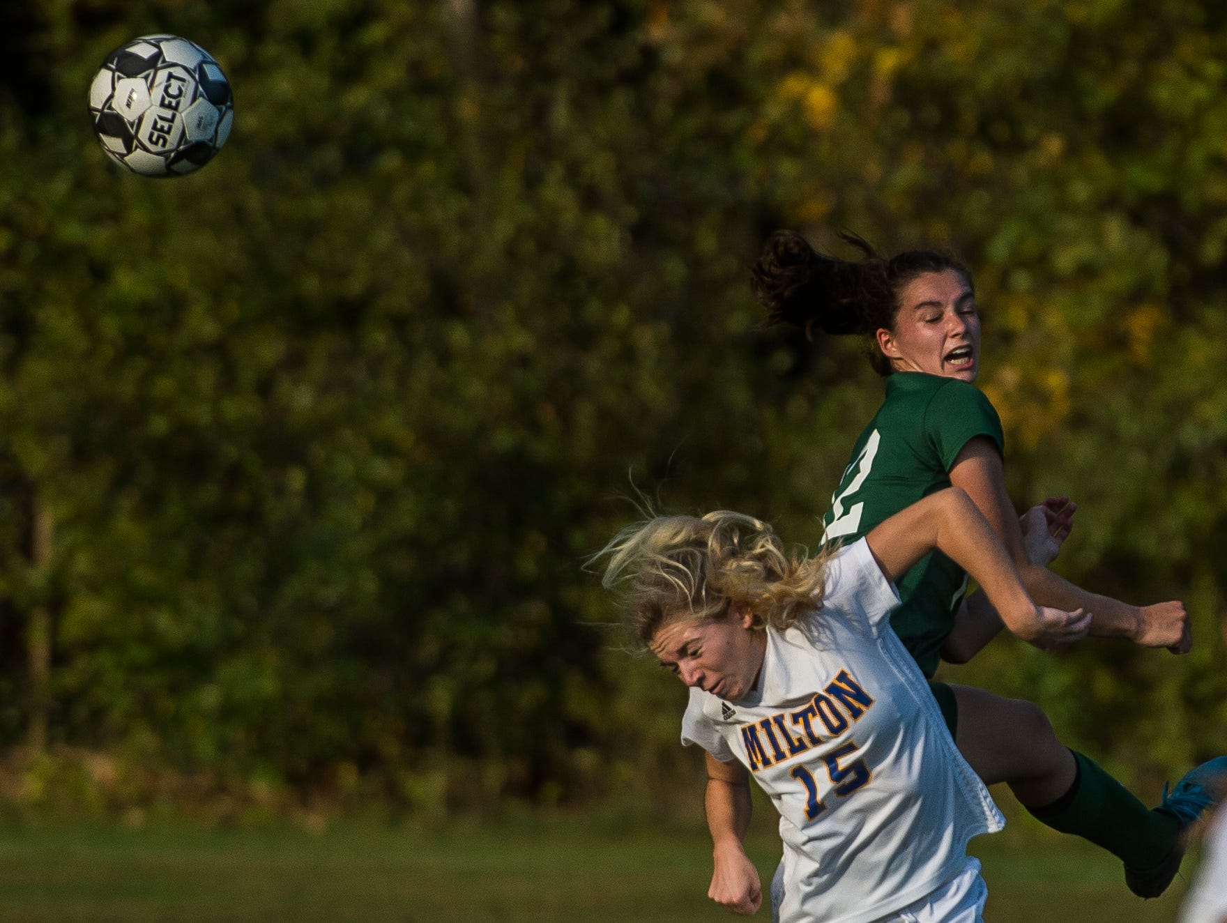 Going to the header, Rice #12 Petra Langan collides with Milton #15 Emma Wennar during their girl's high school soccer game in South Burlington on Wednesday, Oct. 10, 2018. Milton won, 2-1.