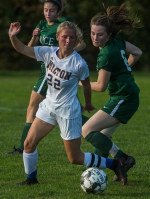Milton #22 Tatum Shappy tries to get past Rice #6 Fiona Connolly during their girl's high school soccer game in South Burlington on Wednesday, Oct. 10, 2018. Milton won, 2-1.