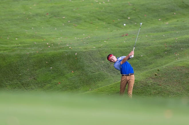 Hartford's Brady Hathorn hits his second shot on the par-4 13th hole during the 2018 high school golf state championships at Country Club of Vermont on Wednesday.