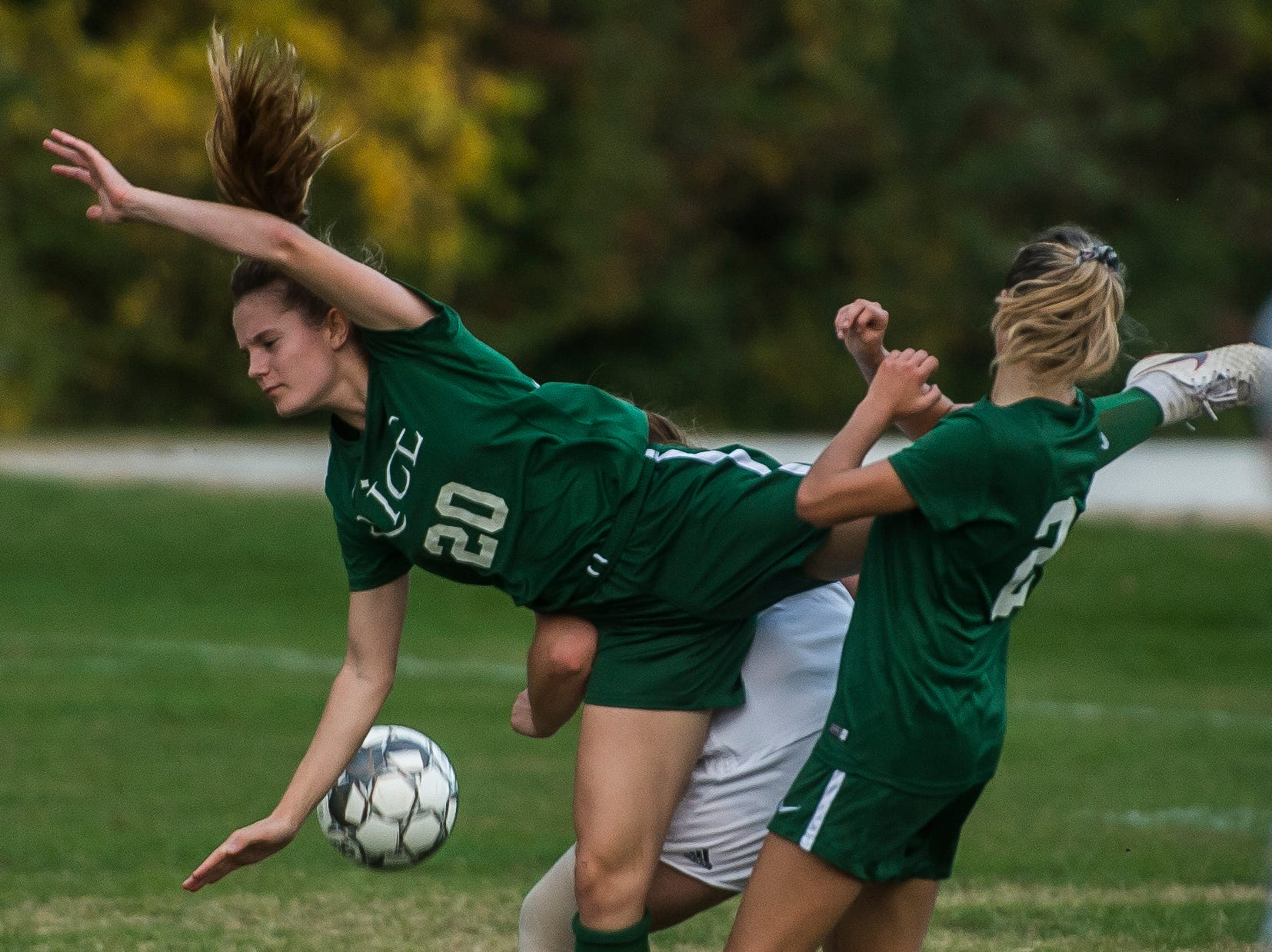 Rice #20 Maris Lynn cart wheels over a Milton midfielder during their girl's high school soccer match up in South Burlington on Wednesday, Oct. 10, 2018. Milton won, 2-1.