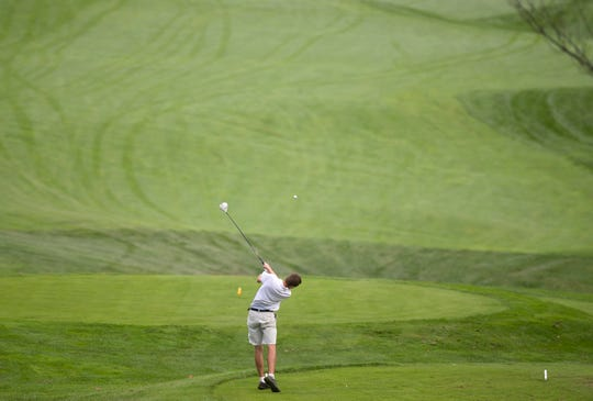 BFA-St. Albans' Andrew Dieringer blasts off the 18th tee during the 2018 high school golf state championships at Country Club of Vermont on Wednesday.