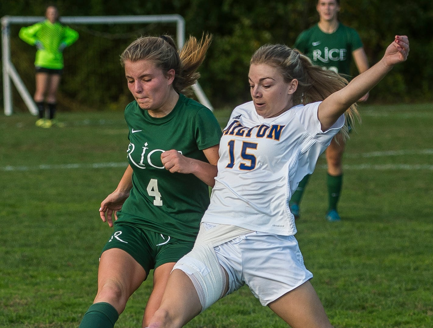 Rice #4 Emma Blanck fights for the ball against Milton #15 Emma Wennar during their girl's high school soccer game in South Burlington on Wednesday, Oct. 10, 2018. Milton won, 2-1.