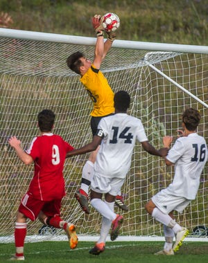 CVU goalie Aidan Johnson snags a lob shot on goal during their boy's high school soccer game in Hinesburg on Tuesday, Oct. 9, 2018. CVU won, 2-0.
