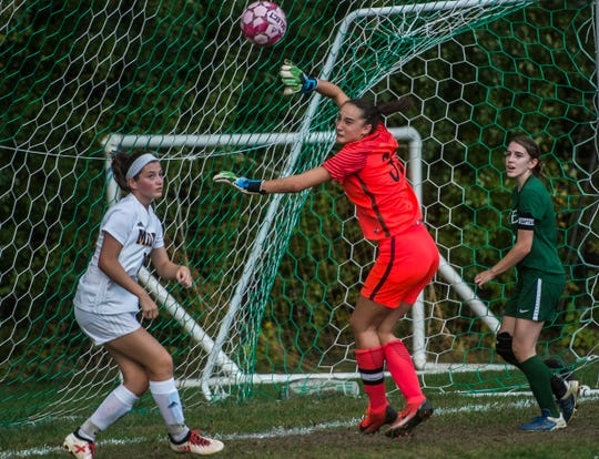 Milton goalie Madison North deflects wide a Rice corner kick during their girl's high school soccer match up in South Burlington on Wednesday, Oct. 10, 2018. Milton won, 2-1.