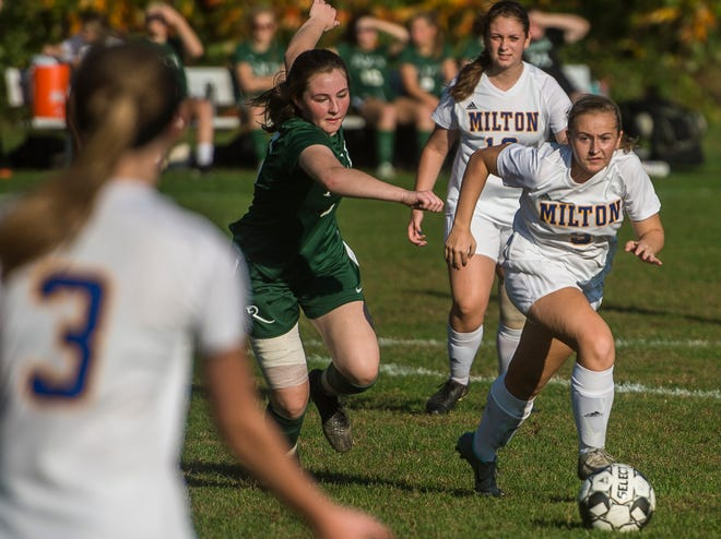Rice #6 Fiona Connolly chases after Milton #9 during their girl's high school soccer game in South Burlington on Wednesday, Oct. 10, 2018. Milton won, 2-1.