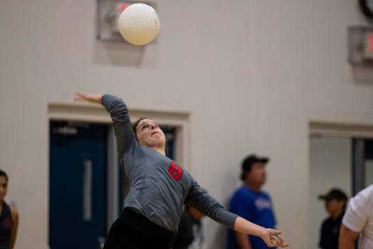 Veterans Memorial's Chelsea spikes the ball during their game against Carroll at Carroll High School on Tuesday, Oct. 9, 2018.