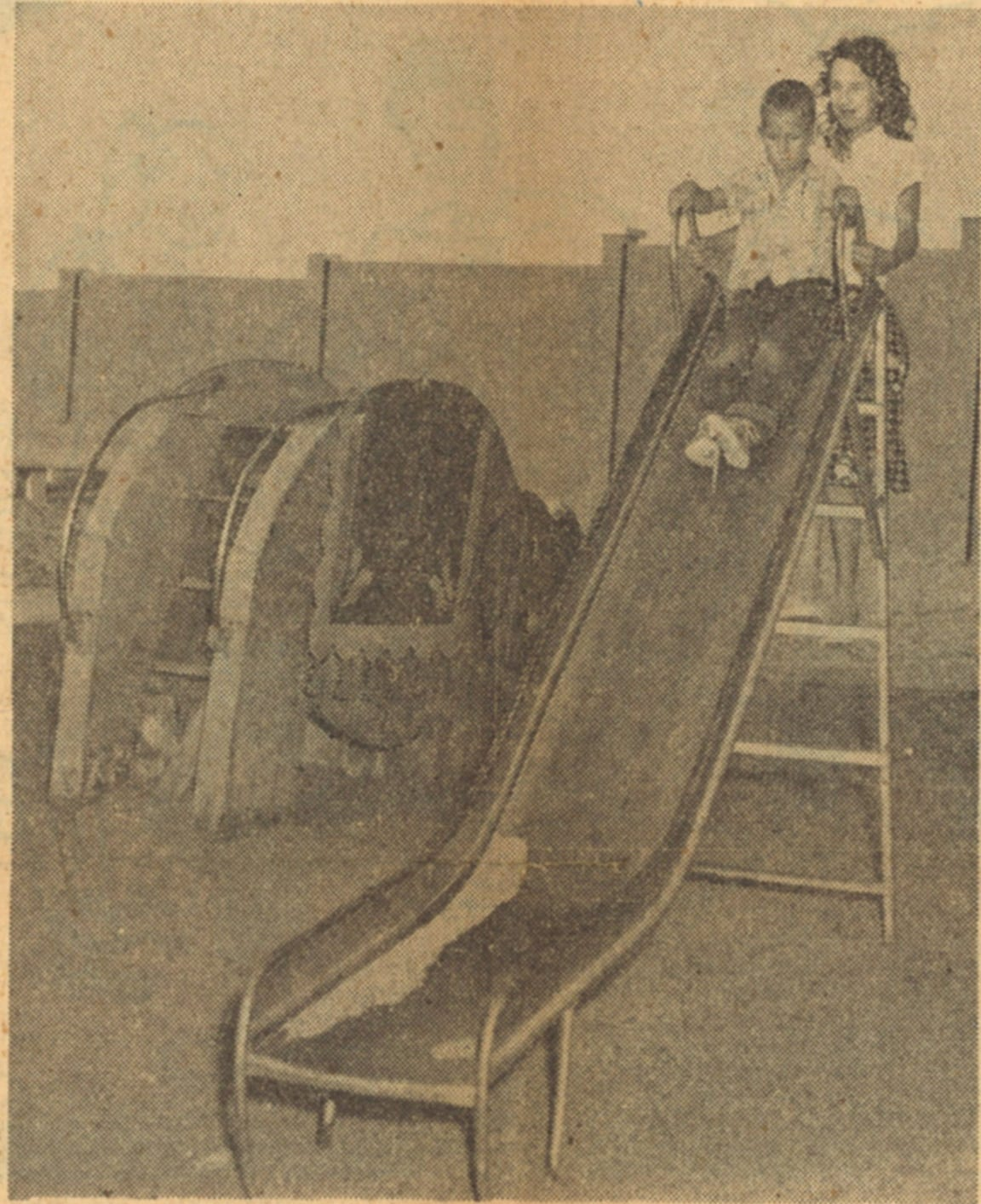 Frances Turner, 14, and her brother Tommy, 7, enjoy a slide at the Corpus Christi Drive-In Theatre before the movie starts. Playgrounds were common at drive-in theaters.
