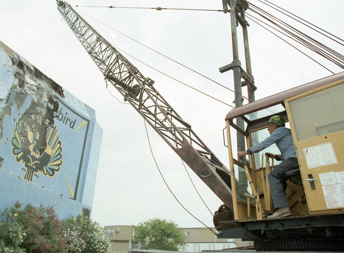 The Thunderbird Drive-In on Leopard Street didn't go down easily as workers began demolishing it on May 4, 1998. At times the structure resisted the blows of the wrecking ball, which sometimes bounced off the building after leaving barely a dent.